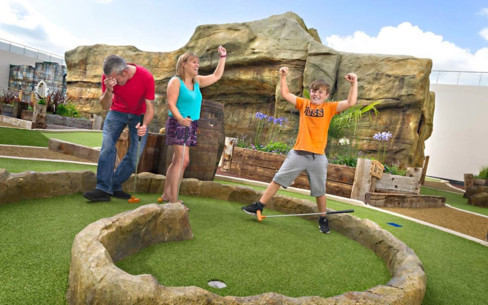A flurry of emotions as a child makes a shot on the crazy golf course course