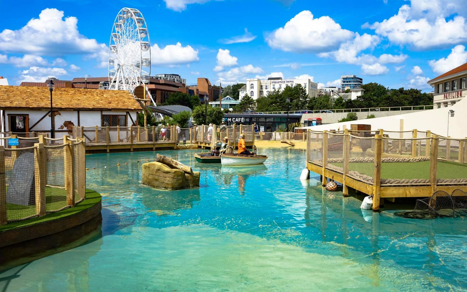 Mini golf course water area with the Bournemouth wheel in the background