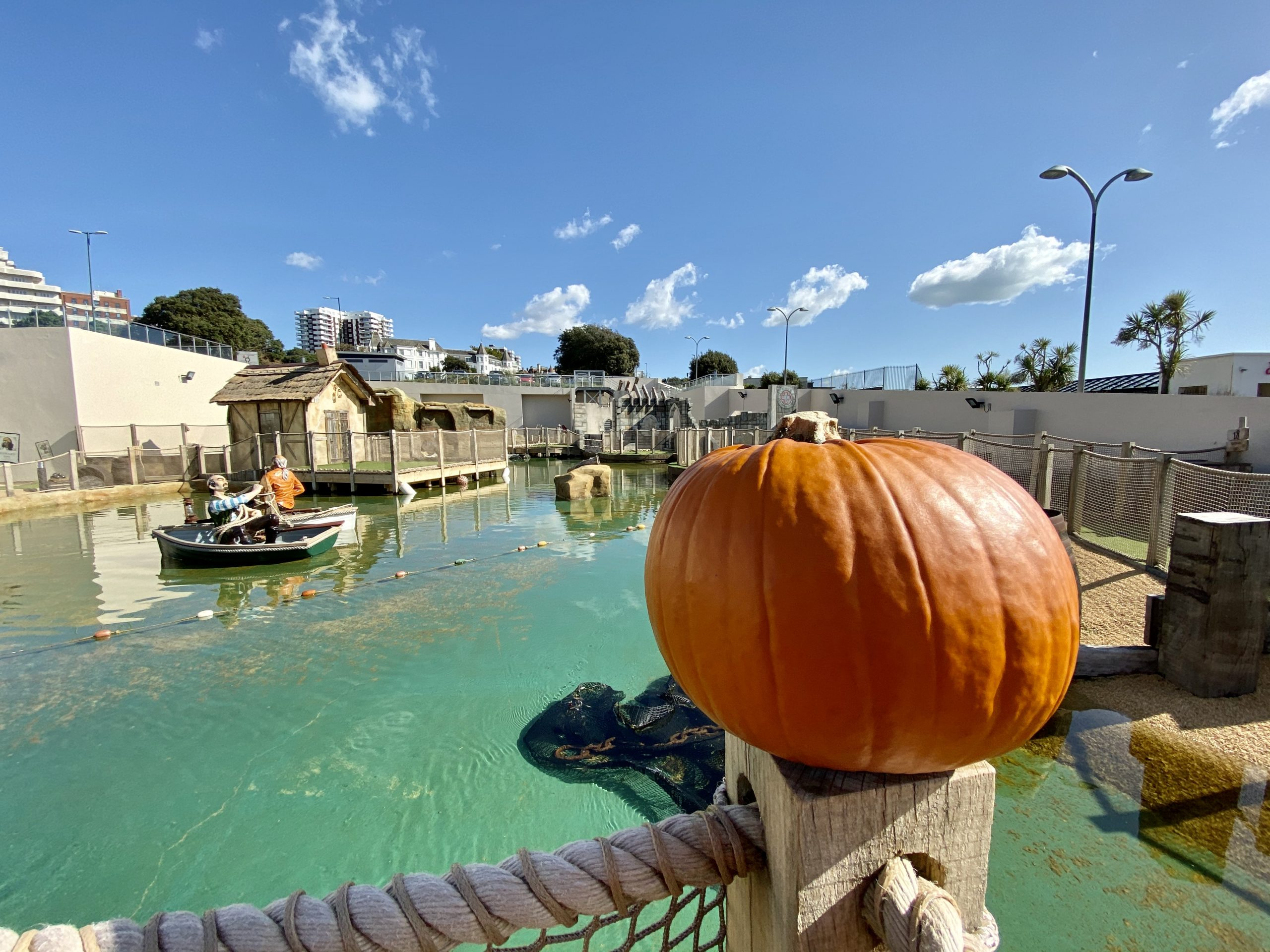 Halloween pumpkin with adventure golf course lake in the backdrop