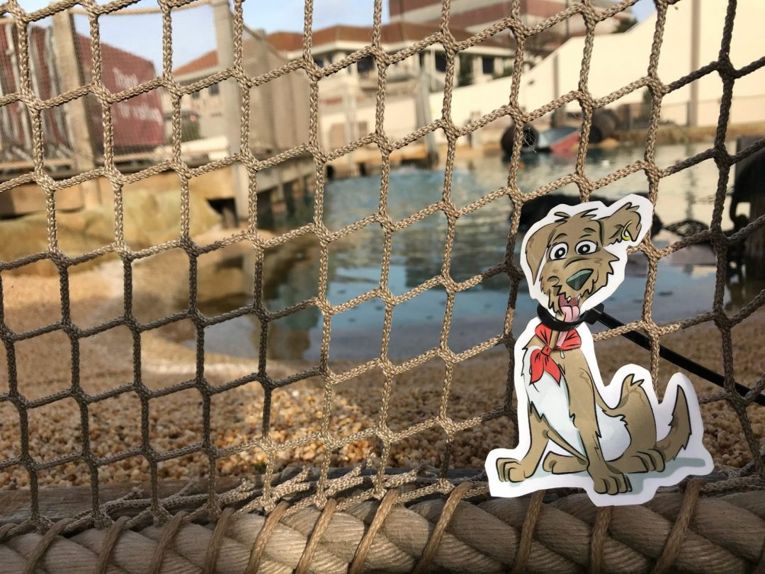 Archie the dog cut out attached to some netting on the crazy golf course